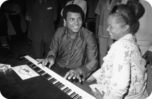 FILE - In this Sept. 22,  1974, photo, Muhammad Ali plays a few notes on the piano as singer Etta James looks on.   The singer's manager says Etta James has died in Southern California.   Lupe De Leon tells The Associated Press the singer died early Friday, Jan. 20, 2012 at Riverside Community Hospital.  De Leon says the cause of death is complications of leukemia. (AP Photo/Horst Faas)
